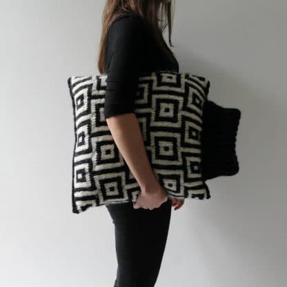 black and white cushion with a turtleneck